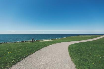 gravel, trail, path, grass, cyclist, cycling, bike, biker, bicycle, coast, water, ocean, sea
