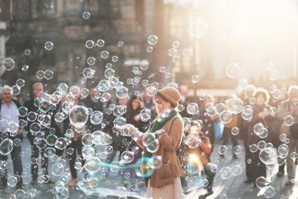 people, crowd, girl, men, water, bubbles, street, sunlight, sunny