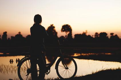 people, man, alone, bike, bicycle, dark, sunset, sky, tree, plant, water, grass, silhouette, nature, outdoor, travel