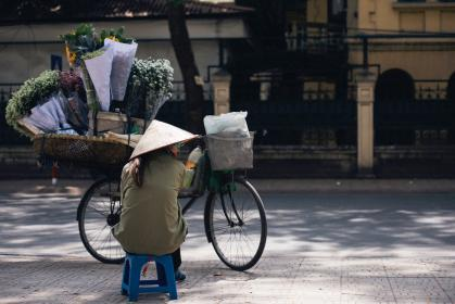 street, vendor, seller, people, woman, hat, sitting, flowers, bouquet