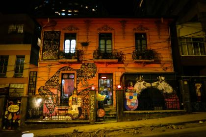 Building in La Paz, Bolivia, graffiti, mural, art, spray paint, building, windows, railings, sidewalk, dark, night, entrance