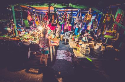 market, store, shop, people, kids, supplies, bags, vendor, sell, stuff, colorful, dark, night, hat