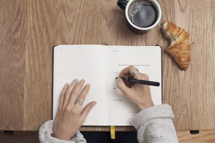 journal, notepad, notebook, pen, writing, hands, office, desk, business, working, coffee, cup, mug, croissant, food, meeting
