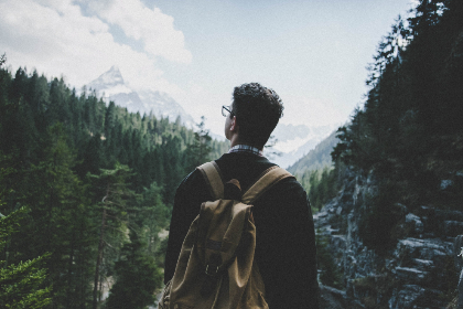 man,  backpack,  travel,  vacation,  holiday,  walk,  trail,  hike,  trees,  clouds,  adventure,  glasses,  rockface,  rock