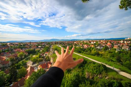 guy, man, male, people, hands, reach, out, nature, neighborhood, suburbs, urban, houses, homes, sky, clouds, horizon, paths, roads, trees