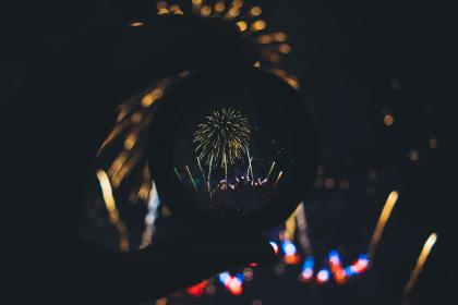 people, hand, snow globe, glass, circle, round, lights, fireworks, dark, night, celebration, party, holiday