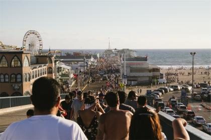 beach, sand, water, ocean, people, pedestrians, crowd, summer, ferris wheel, amusement park, fair, sunshine, cars, streets, roads, group