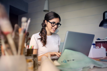 woman,  work,  laptop,  computer,  desk,  office,  smile,  glasses,  art,  paint,  brush,  studio,  girl,  people