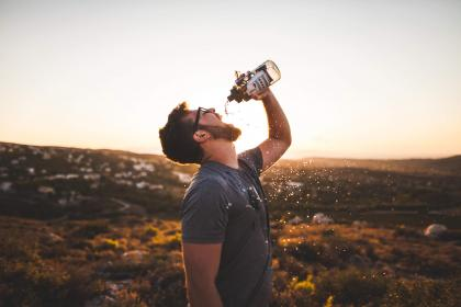 guy, man, drinking, water, water bottle, thirsty, beard, glasses, people, sunshine, sunset, tshirt, outdoors, hiking
