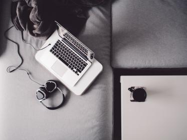 macbook, laptop, headphones, deck, black and white, modern, couch, table, cup, mug, coffee