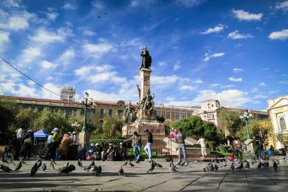 La Paz, Bolivia, landmark, monument, statue, people, pedestrians, pigeons, birds, buildings, architecture, city, urban