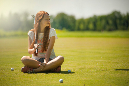 woman,  cross legged,  golf,  course,  sunny,  warm,  ball,  sport,  people,  girl,  female,  shorts,  trees,  green,  nature
