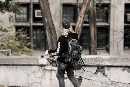 skater, young, man, teenager, backpack, skateboard, black, jeans, sweater, hoodie, blonde, concrete