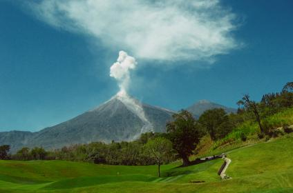 voclano, smoke, ash, mountain, golf course, fairway, green, hole, pin, trees, grass, outdoors, sky, blue