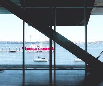stairway,  interior,  building,  glass,  windows,  water,  waterfront,  boat,  ocean,  silhouette,  pier,  daytime,  boats,  sea,  city,  horizon