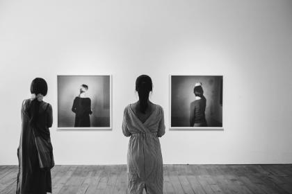 people, woman, girl, female, back, black and white, wall, indoor, photo, frame