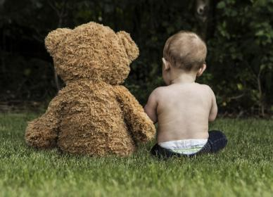 green, grass, grassland, outdoor, landscape, nature, baby, kid, child, toddler, playing, teddy bear, stuffed toy