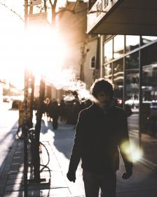 people, man, smoke, urban, city, sun, flare, street, shadow