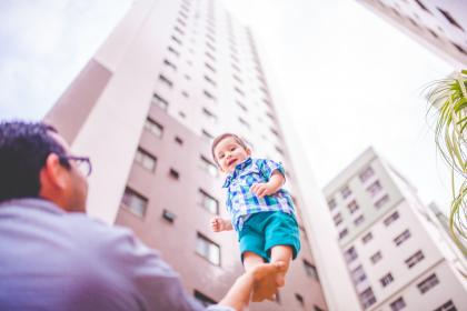 building, tower, sky, blur, people, man, kid, baby, father, son, child, playing, happy, smile, outdoor