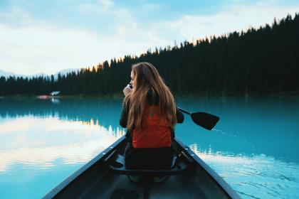 people, woman, girl, sailing, boat, paddle, lake, blue, water, trees, cloud, sky, silhouette