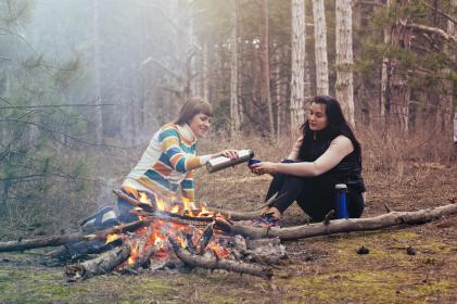 women, girls, talking, smile, happy, friends, sitting, trees, fire, camping, travel, outdoor, drinks, firewood, forest