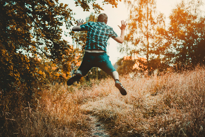 man,  jumping,  forest,  trail,  walk,  hike,  male,  sunset,  trees,  grass,  green,  shirt,  shorts,  jeans,  leap