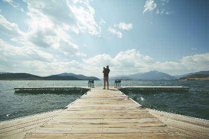 man,  child,  pier,  sunny,  blue,  sky,  white,  clouds,  calm,  day,  water,  lake,  river,  jetty,  dog,  animal,  pet,  people,  family