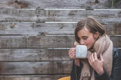 wooden, wall,  people, woman, girl, female, cold, weather, shawl, coat, coffee, cup, relax