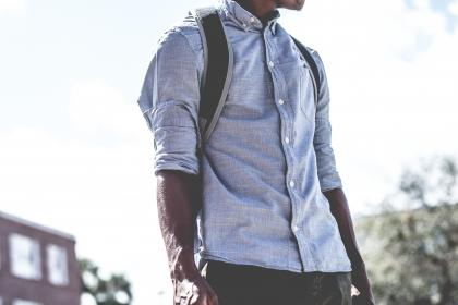 guy, man, fashion, clothing, backpack, african american, bokeh, building, plants, trees, street, male, sunlight, clouds