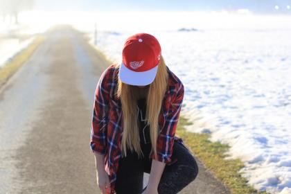 people, girl, woman, lady, walking, alone, street, road, grass, snow, winter, travel, outdoor, red, cap