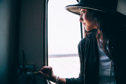 woman,  looking,  window,  person,  female,  lady,  train,  transport,  travel,  hat,  fashion
