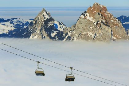 chair lift,   ski lift,   ropeway,   cable car,   summit,   peak,   cliff,   rock,   Swiss Alps,   Alps,   alpine,   landscape,   nature,   sea of fog,   fog,   sea,   Kleiner Mythen,   Grosser Mythen,   Mythen,   mountain,   Schwyz,   Swiss,   Europe,   winter,   wintertime,   snow,   white,   blue