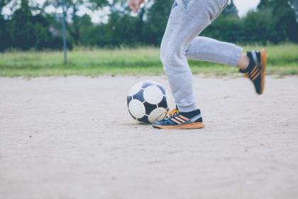 people, man, shoe, ball, soccer, sport, game, play, field, ground, tree, plant, nature, outdoor