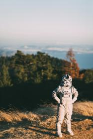 people, man, alone, costume, astronaut, science, sunny, day, travel, grass, highland, blur, sky, clouds