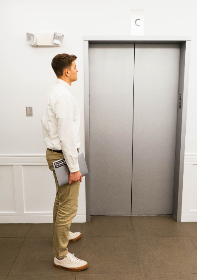 elevator,  building,  person,  waiting,  man,  business,  executive,  city,  ceo,  floor,  laptop,  technology,  corporation,  casual, office