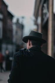 blur, people, man, male, walking, alone, back, black coat, hat