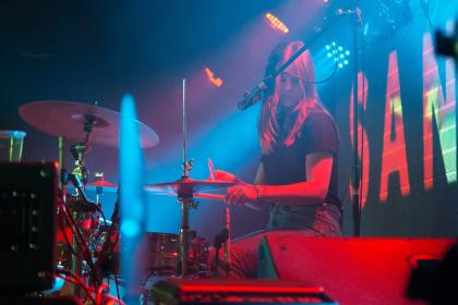 people, woman, drummer, drums, cymbals, sticks, performance, concert, dark, night, bar