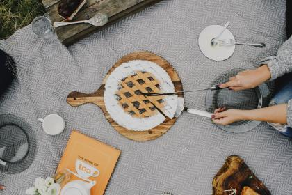 outdoor, camping, plate, utensils, spoon, fork, cloth, tea, book, flower, white, peatals, pan