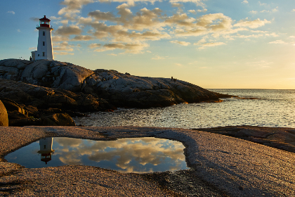 lighthouse,   sky,   architecture,   rock,   coast,   ocean,   island,   landmark,   light,   building,   scenic,   historic,   water,   horizon,  sea,  sky,  clouds,  sunset,  sunrise,  reflection