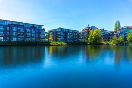 architecture, building, infrastructure, city, blue, sky, lake, water, reflection, tree, plant