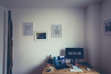 room, office, desk, screens, laptop, keyboard, mouse, pictures, frames, white, walls