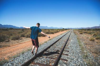 railway, track, outdoor, mountain, view, sunny, day, sky, grass, people, man, playing, guy