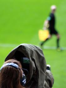 people, woman, man, athlete, videographer, journalist, media, video, headphones, soccer, green