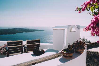 mountain, sea, ocean, water, building, resort, chairs, flower, pot, plant, sunny, summer, vacation, sky, travel
