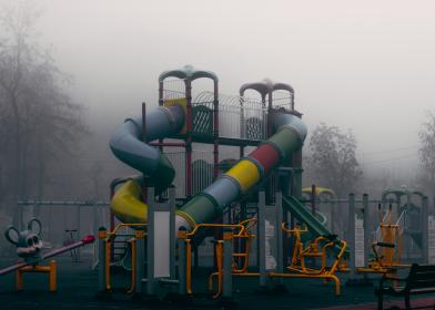 playground, play structure, park, slides, fun, grey, fog, foggy, clouds, cloudy