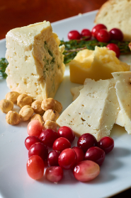 cheese,   plate,  platter,  assortment,  cheeses,  appetizer,  food,  dairy,  fruit,  cheddar,  grapes,  blue,  brie,  gourmet