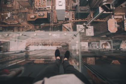 urban, city, establishment, building, structure, infrastructure, tower, aerial, people, man, feet, shoes, roof top, car, vehicle, transportation