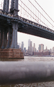 bridge,   water,   sky,   suspension,   travel,   ocean,  city,  architecture,  new york city,  overcast,  cloudy,  buildings,  tall,  view,  urban,  road