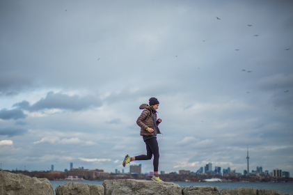 woman,  running,  city,  clouds,  sky,  outdoors,  cityscape,  buildings,  skyscrapers,  female,  person,  alone,  birds,  exercise,  fitness,  wellness,  activity,  energy,  jog