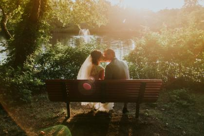 marriage, wedding, couple, love, man, woman, people, kiss, bench, trees, nature, sunshine, sunlight, water, river, lake, sweet, gown, suit, wedding dress